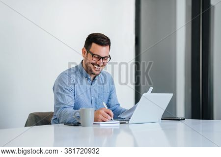 Portrait Of A Cheerful Man Having Video Call On Laptop Computer Cheerful Businessman Using Laptop In