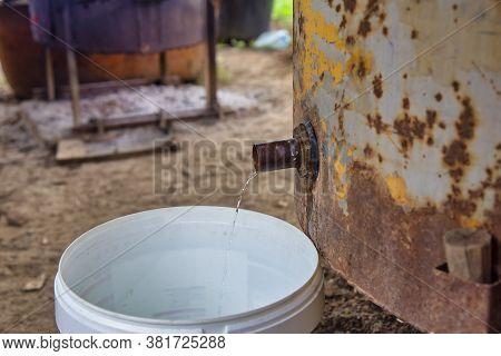 Slivovitz Or Rakija (plum Brandy) Dripping Into The Bucket. Traditional Homemade Distillery, Final P