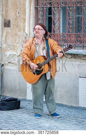 Timisoara, Romania - April 02, 2016: Man Singing And Playing His Guitar In The Street. Real People.