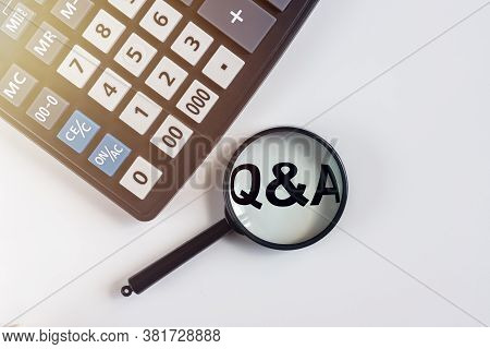 Q And A Written On White Office Table With Calculator. Financial Questions And Answers Concept, Q An