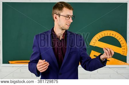 Male Teacher Hold Protractor. Education And School Concept. Stem School Disciplines. Mathematics And