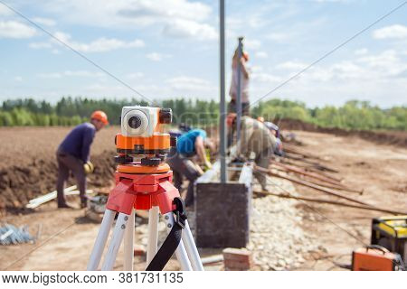 Construction Equipment. Surveyors Equipment Theodolite On The Construction Site. Monitoring The Prog