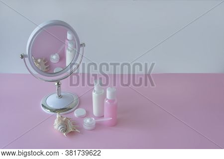 Untitled Container And Cosmetic Bottles On Pink Background, Mirror With Reflection. Natural Organic