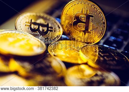 Bitcoin Coins On Laptop Keyboard. Cryptocurrency Background.