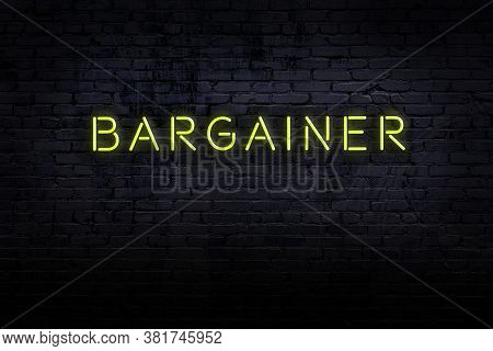 Neon Sign On Brick Wall At Night. Inscription Bargainer
