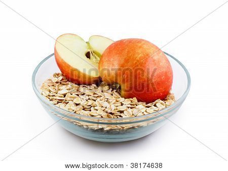 Oats And Apple Halves In Transparent Bowl