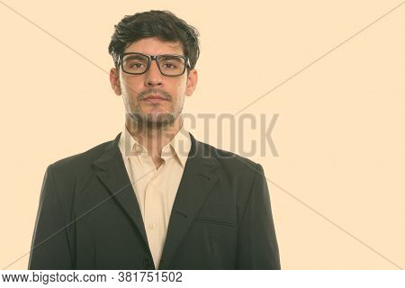 Studio Shot Of Young Persian Businessman Wearing Eyeglasses