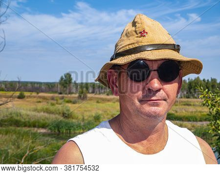 A Man In A Military Hat With A Star. Soviet Soldier. A Red Star. Sunglasses. Soviet Army. A Man With
