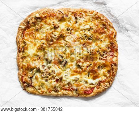 Delicious Tapas, Snack, Appetizer. Canned Tuna, Tomatoes, Mozzarella Cheese Pizza On A Light Backgro