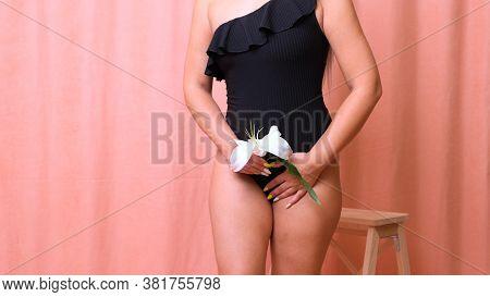 Bikini Area Depilation. Advertising Brazilian Laser Bikini Line Hair Removal. Woman In Black Swimsui