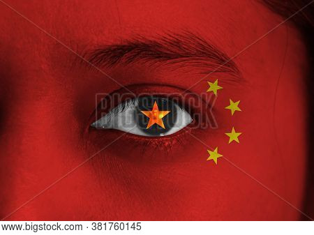 Human Face Painted China Flag With Yellow Star On The Center Of Eye Or Eyeball. Human Eye Painted Wi