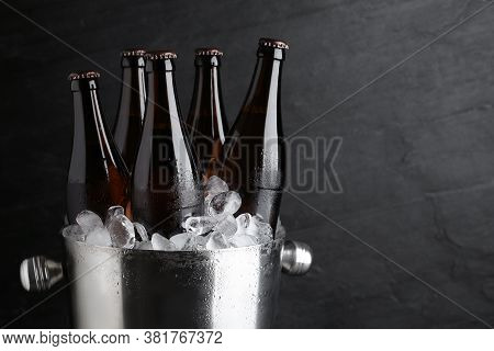 Metal Bucket With Beer And Ice Cubes On Black Background, Closeup. Space For Text