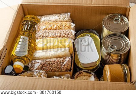 Set Of Uncooked Foods In Carton Box Prepared For Disaster Emergency Conditions Or Giving Away Closeu