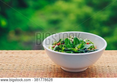 Beautiful Raw Vegan Salad From Green Leaves Mix Vegetables In White Plate. Cooking Recipe Blended To
