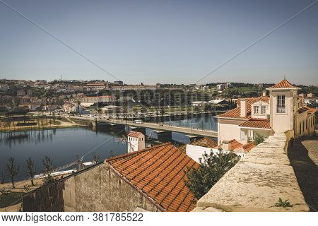 Views Of The City Of Coimbra Portugal From The Hill To The River, Bridge And Historic Buildings. Cit