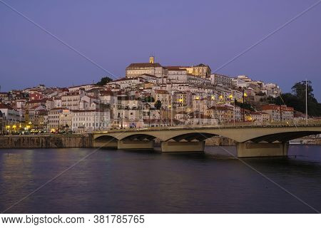 03.11.2019 City Of Coimbra In Portugal Evening Panorama At Sunset Illuminated At The Bridge Over The