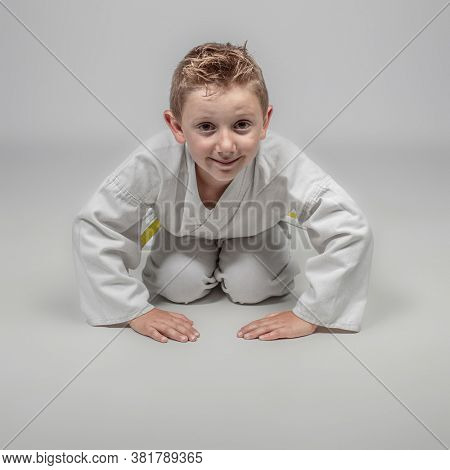 child with kimono in rei position. martial arts practitioner.