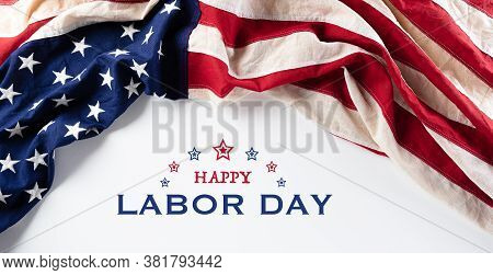 American Flags Against White Background. Flat Lay With Copy Space. Happy Labor Day Concept.