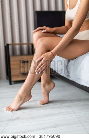People, Beauty, Depilation, Epilation And Bodycare Concept. Beautiful Woman With Bare Legs Sitting O