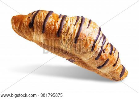 Croissant With Chocolate Glaze On A White Isolated Background