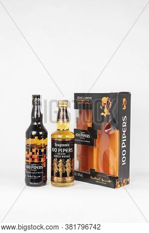 Palma, Mallorca, Spain - April 22 2019: Seagram's 100 Pipers De Luxe Blended Scotch Whisky Bottles W