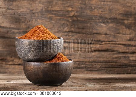 Paprika Powder In Two Wooden Bowls - Capsicum Annuum