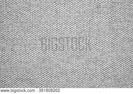 Close-up Of A Gray Textured Fabric. Macro Shot Of Gray Upholstery For Furniture. Wallpaper And Backg