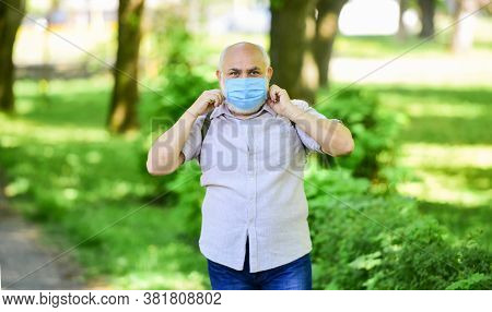 Wear Mask In Park. Care Your Health. Protect Yourself From Virus. Man In Protective Mask. Walking Ou