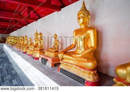Phitsanulok, Thailand - July 04 2020 Row Of Gold Buddha Statue At At Phra Si Rattana Mahathat Temple