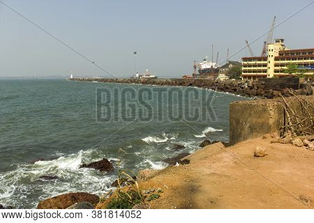 Goa, India - February 28, 2013: Wide Angle Of Vasco Port With Ship Docked By The Rocky Beach