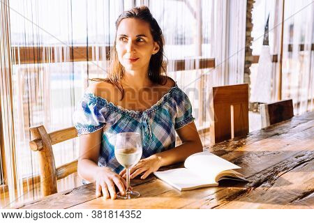 Beautiful woman portrait with wine. Beauty Woman face Portrait. Beautiful model woman portrait. Stylish woman portrait with glass of wine. Beautiful woman portrait. Woman fashion portrait. Woman drinking wine. Woman portrait in restaurant. Wine restaurant