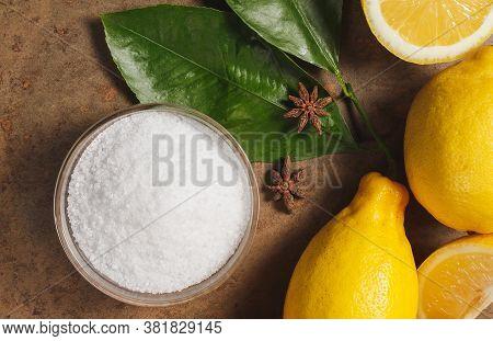 Citric Acid And Lemons On Stone Background