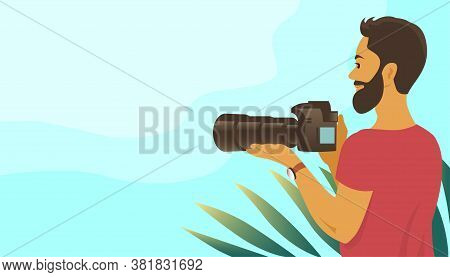 A Young Man With A Beard Takes Pictures With A Camera. Long Telephoto Lens. Stands Among A Tropical