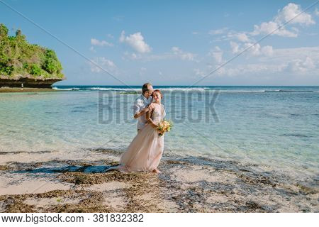 July 5, 2020. Bali, Indonesia. Wedding Day Of Bride And Groom At Tropical Beach. Happy Wedding In Tr