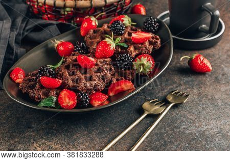 Chocolate Waffles With Milk And Berries For Breakfast On Dark Background. Chocolate Cookies Amerikan