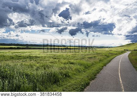 A Summer Storm Forms Over A Section Of The Trans Canada Trail At Glenbow Provincial Park Alberta.