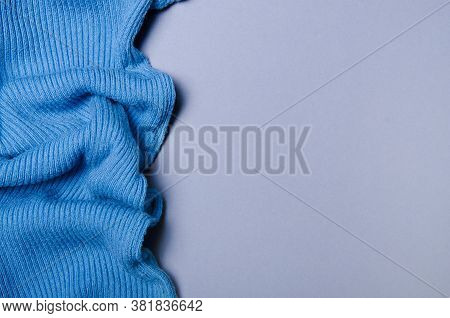 Blue Sweater Blanket Warm Fabric On Gray Background, Top View