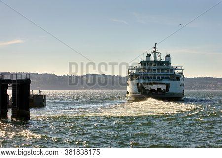 Washington State Ferry Departure. A Washington State ferry leaves the dock on Puget Sound. Washington State.