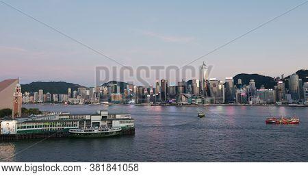 Victoria Harbor, Hong Kong 30 July 2020: Hong Kong city at sunset