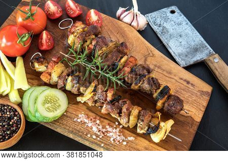 Kebabs - Grilled Meat And Vegetables. Pork Skewers On Wooden Cutting Board. Fresh Tasty Barbecue On