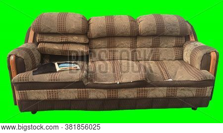 Old And Useless Sofa Over Green Background