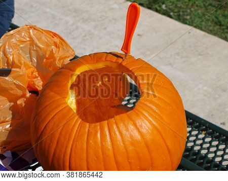 Here, The Pumpkin Is Finished And The Carving Knife Is Placed In A Seam Of The Pumpkins Skin  Should