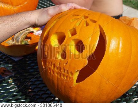 The Added Designs Are Much Like Tatoos. They  Add To The Features Of This Pumpkin.