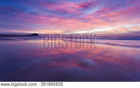 A Beautiful Coloured Sunrise At Nobbys Beach - Newcastle Nsw Australia. The Coastline Around Austral