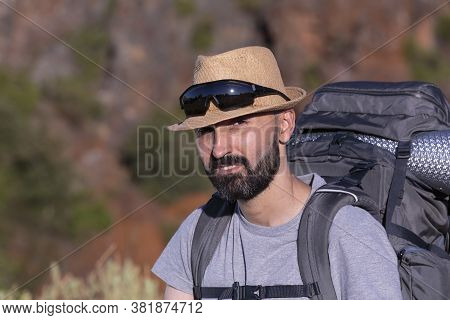 Handsome Hispanic Male Trekker Looking At Camera