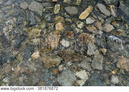 Abstract Design Formed By Various Numbers Of Pebbles Scattered In The River, Background Texture Of P