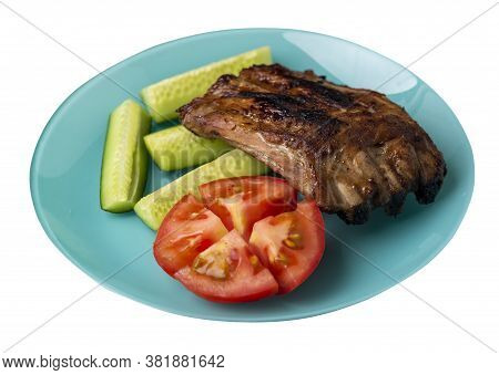 Grilled Pork Ribs With Sliced Cucumbers And Tomatoes On Turquoise Plate. Pork Ribs Isolated On White