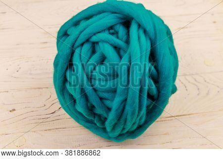 Merino Wool Yarn Ball On White Wooden Background