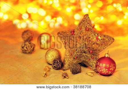Christmas background with gold and red bulbs, star and blurs