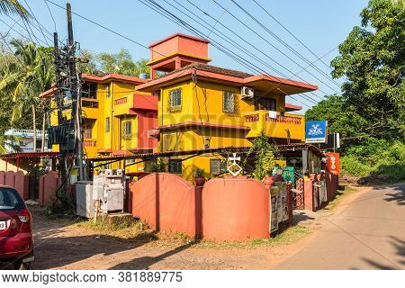 Candolim, North Goa, India - November 23, 2019: Street View Of Candolim At Sunny Day With Typical Ho